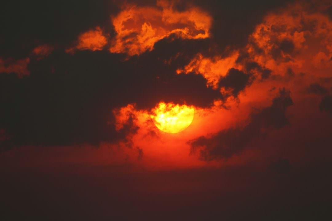 Sun, smoke and clouds. Image - Ed Dunens, flickr